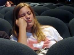 Girl sleeping in cinema
