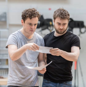Joshua McGuire (Guildenstern) and Daniel Radcliffe (Rosenctantz) in Rosencrantz & Guildenstern Are Dead. Photo by Manuel Harlan