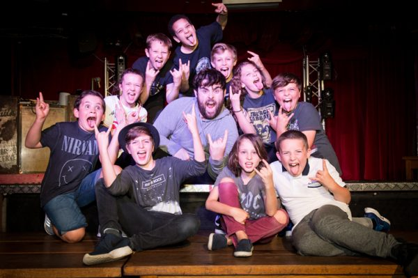 David Fynn (Dewey Finn) centre and the School of Rock kids