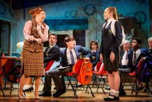 Front LtoR Lara Dennings as Miss Elf, Rufus Kampa as Adrian, Rebecca Nardin as Pandora and Cast in Adrian Mole the Musical, credit Pamela Raith.